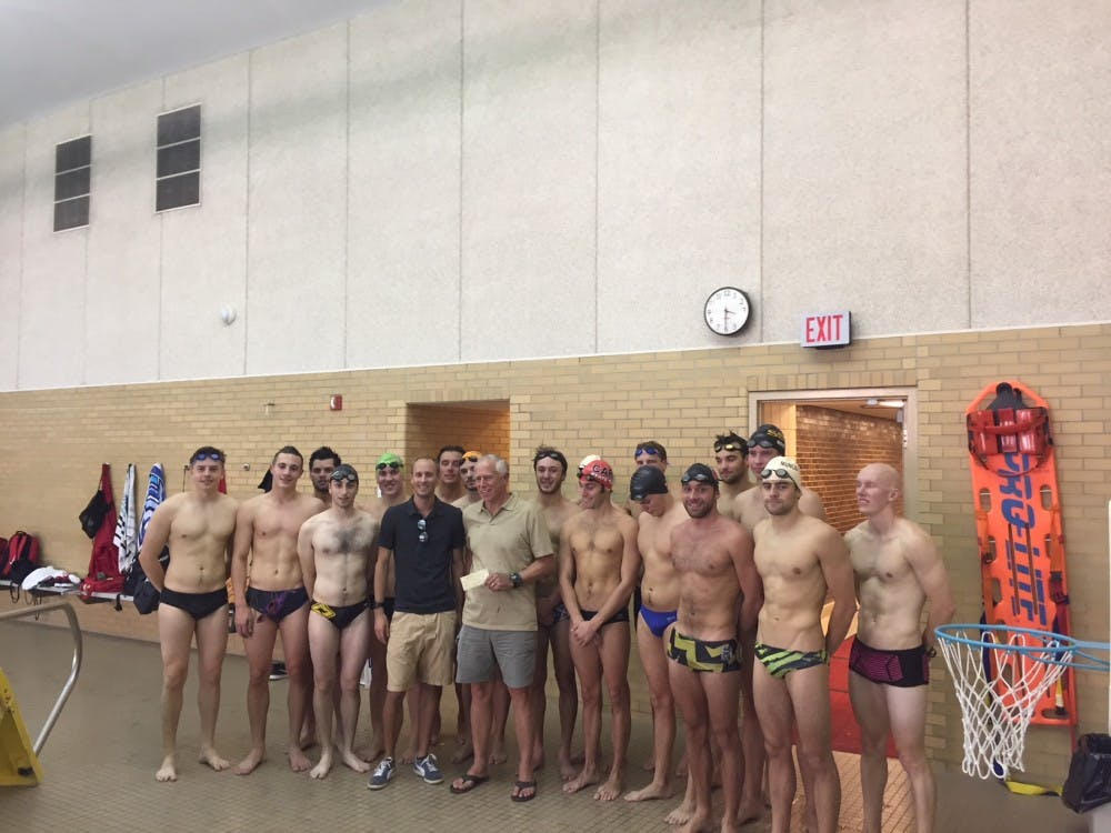 <p>Former Ball State diver Zach Whitaker stands with the current men's swimming and diving team. Whitaker gave the men's swimming and diving program was $1,000, mini refrigerator for the team's locker room and cases of Gatorade to stock it. Zach Whitaker, Photo Provided</p>