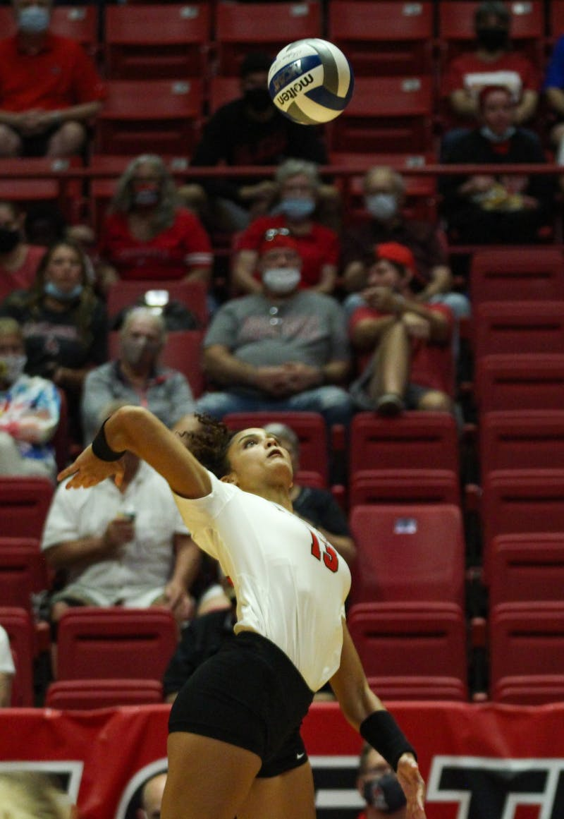 Junior opposite hitter Natalie Mitchem spikes the volleyball set to her by freshman Megan Wielonski against Northern Kentucky in Worthen Arena Sept. 17. Ball State took the win for its first home game of the 2021 season. Jacy Bradley, DN