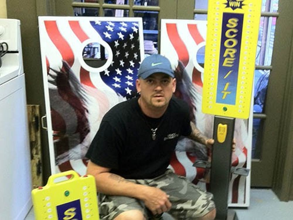 Paul Dytmire, a Muncie native, invited a corn hole score keeping device that took a prestigious award at a trade show. The Awkward will help him sell his invention to an investor. PHOTO PROVIDED BY Paul Dytmire