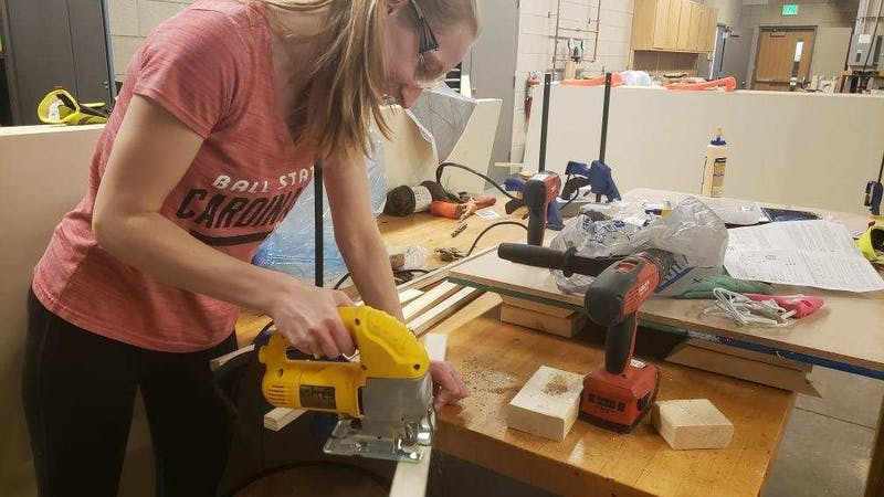 Natalie Hopf, senior interior design major, helps build equipment for Children's TheraPlay pediatric clinic. Shireen Kanakri, associate professor of interior design who led the project, said the partnership with the clinic was important due to a gap in interior designing to produce designs that benefit children with autism. Emily Schripsema, Photo Provided