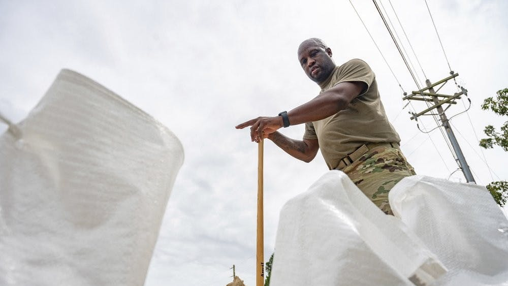 Anthony Woods, who serves in the Army, counts the sandbags that he will use help protect his home in Gulfport, Miss., as Hurricane Sally slowly approaches the coast on Monday, Sept. 14, 2020. (Lukas Flippo/The Sun Herald via AP)