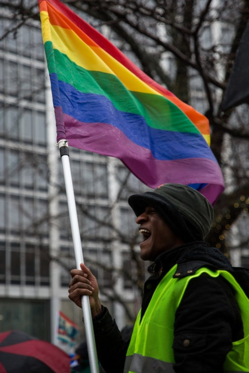 Andrew Brown stands at Monument Circle in Indianapolis Jan. 19, where participants in Indiana's Women's March gathered before heading to the American Legion Mall for the rally. Student Government Association passed a resolution that would create a LGBTQ liaison position for students. Eric Pritchett, DN