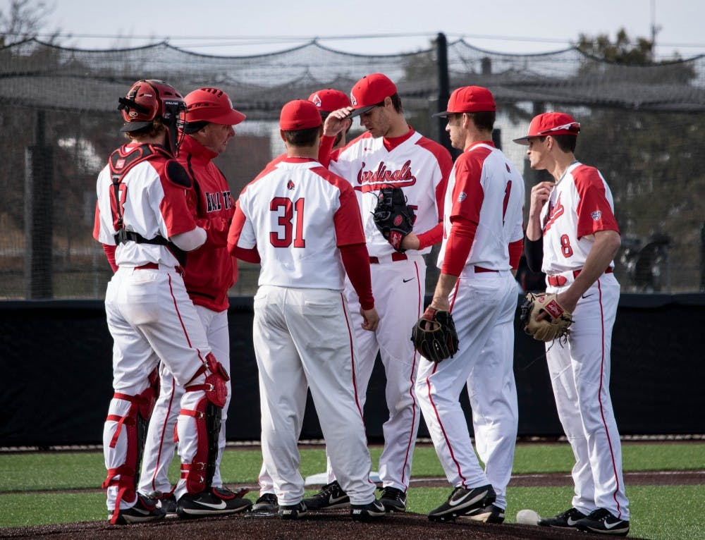 <p>Ball State's infield meets during a mound visit in the top of the ninth inning March 16, 2018, against Dayton at Ball Diamond at First Merchants Ballpark. Despite Ball State's efforts, Dayton won the game, 4-3. <strong>&nbsp;Rebecca Slezak, DN</strong></p>