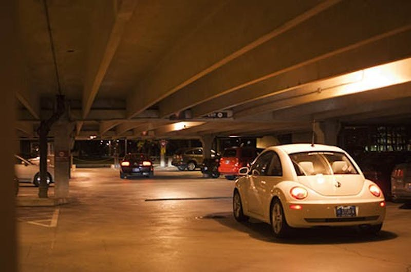 This 2013 file photo shows a car driving through the Emens parking structure. After being around for around 50 years, the parking garage will be closed permanently and demolished during the summer. Jonathan Miksanek, DN File