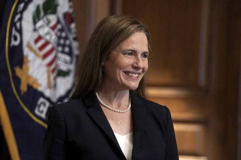 Supreme Court nominee Amy Coney Barrett, meets with Sen. Martha McSally, R-Ariz., Wednesday, Oct. 21, 2020, on Capitol Hill in Washington. Barrett was confirmed to the Supreme Court Oct. 26, 2020. (Greg Nash/Pool via AP)