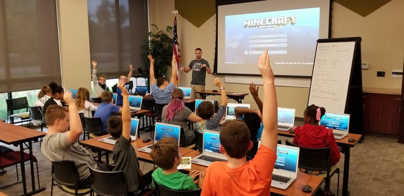 Ryan Hunter, co-founder of TechWise Academy, leads a Minecraft Party in which students get to learn about command blocks and play online in a safe environment. TechWise began regular coding classes for K-12 students in August. Brandon Coppernoll, Photo Provided