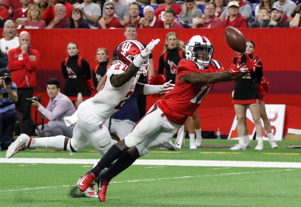 <p>Ball State junior wide receiver Justin Hall lungs for the ball while being guarded by Indiana University sophomore defensive back Devon Matthews Saturday, Aug. 31, 2019 at Lucas Oil Stadium. The ball was not caught. <strong>Paige Grider, DN</strong></p>