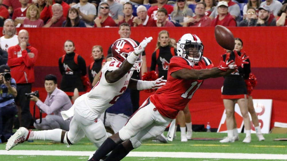 Ball State junior wide receiver Justin Hall lungs for the ball while being guarded by Indiana University sophomore defensive back Devon Matthews Saturday, Aug. 31, 2019 at Lucas Oil Stadium. The ball was not caught. Paige Grider, DN