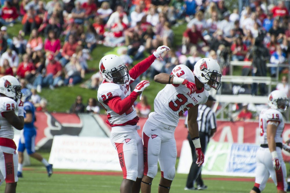 Senior Quintin Cooper and redshirt sophomore Tyree Holder celebrate after a play at the football game against Indiana State on Sept. 13 at Scheumann Stadium. DN PHOTO ALAINA JAYE HALSEY