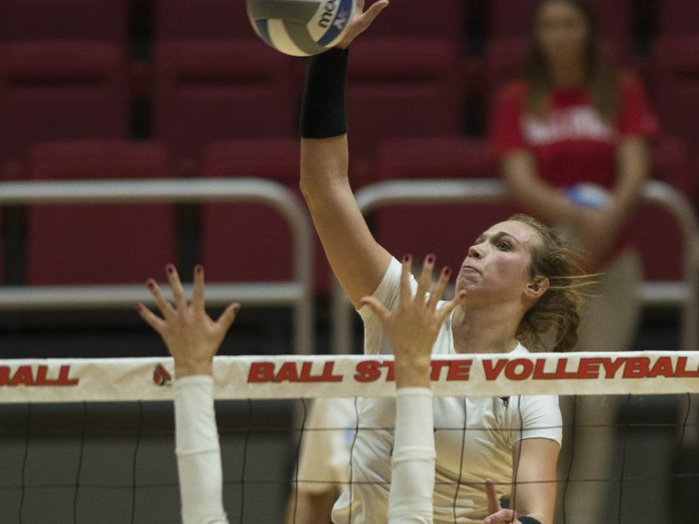 Freshman outside hitter Kia Holder tightens her braid before the a set begins against Bowling Green on Oct. 20 at John E. Worthen Arena. Holder led the team in kills with 17. Breanna Daugherty, DN
