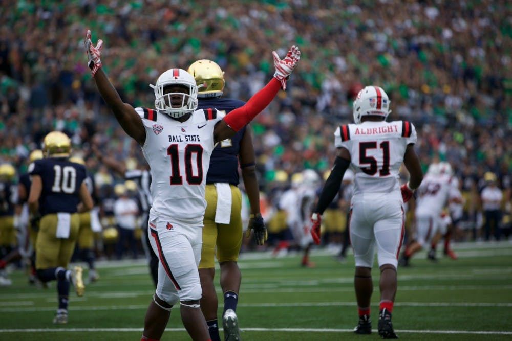 <p>Ball State's Lamar Anderson, junior, pumps up the crowd after an excellent play by the Cardinals Saturday, Sept. 8, 2018, at Notre Dame Stadium. The Cardinals lost 24-16. Anna Hite,DN</p>