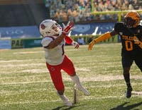 Ball State graduate student wide receiver Antwan Davis reaches for the ball against Toledo senior cornerback Samuel Womack Nov. 28, 2020 at the Glass Bowl in Toledo, Ohio. Davis finished Saturday's 27-24 win with 41 receiving yards against the Rockets. Maeve Bradfield, Ball State Athletics.