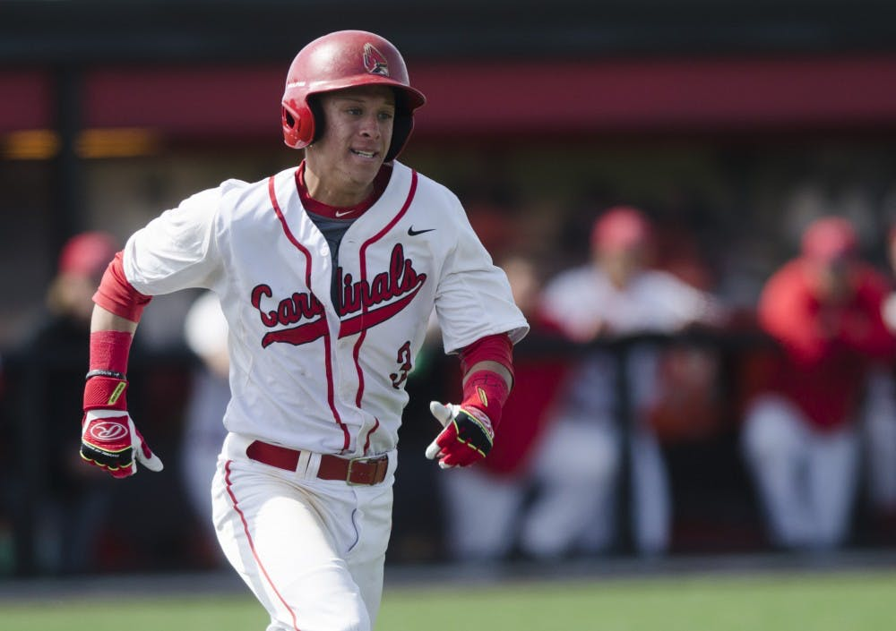 Sophomore outfielder Roman Baisa runs to first base during the game against Ohio University on April 2 at the First Merchants Ballpark Complex. Ball State lost 10-0, bringing the Cardinals losing streak to eight games in a row. Emma Rogers // DN