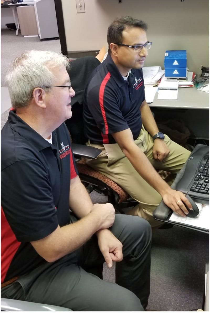 Micheal Hicks, director of Center for Business and Economic Research, and Srikant Devaraj, research economist and research assistant professor, go over their study. The 2019 Manufacturing Scorecard gave Indiana an A grade in both its manufacturing and logistics industry. Photo Provided, 2019.