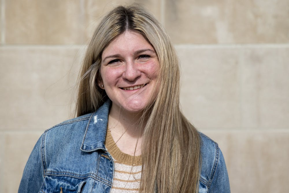 <p>Mia Marerro, senior creative writing major poses for a photo Nov. 10, 2020, outside of the David Owsley Museum of Art. Marerro said she enjoys creative writing because it allows her to be vulnerable and share a whole new world with her readers. <strong>Jacob Musselman</strong></p>