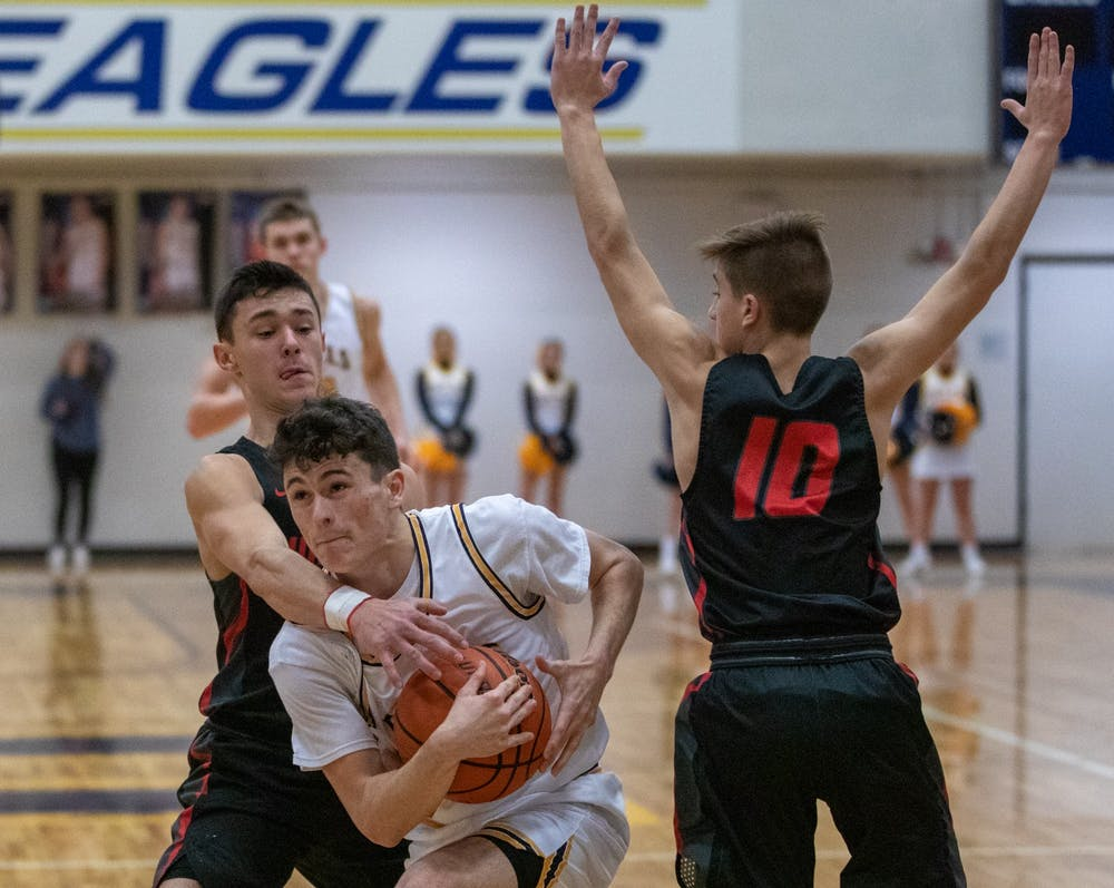 <p>Senior point guard Connor Bedwell takes on a Wapahani player Jan. 31, 2020, at Delta High School. The Eagles beat the Raiders 54-43. <strong>Jacob Musselman, DN</strong></p>