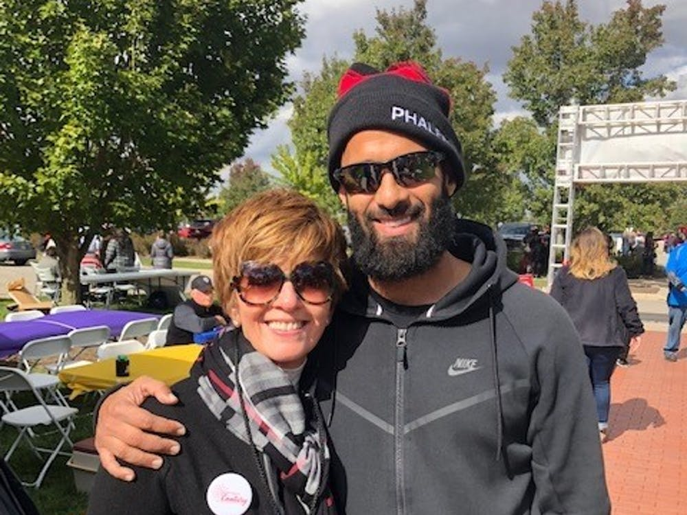 : Renae Conley, chair for the Ball State Board of Trustees, takes a photo with her son Ali Conley. Renae also currently serves as CEO of ER Sollutions LLC. Ball State University, Photo Provided