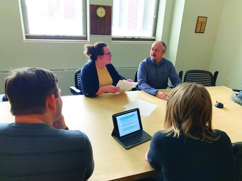 Michale DeLong relays the plans of her group to Adam Rude, an advisor for the one credit hour, independent study course dedicated to the ELECTRI International Green Energy Challenge. With her are group mates Cassie Deorony and Kevin Zielinski. Michale DeLong, photo provided