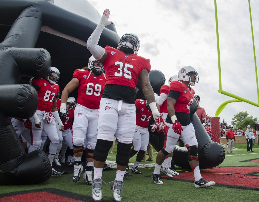 The Ball State football team runs out onto the field before the game against Western Michigan on Oct. 11 at Scheumann Stadium. DN PHOTO BREANNA DAUGHERTY