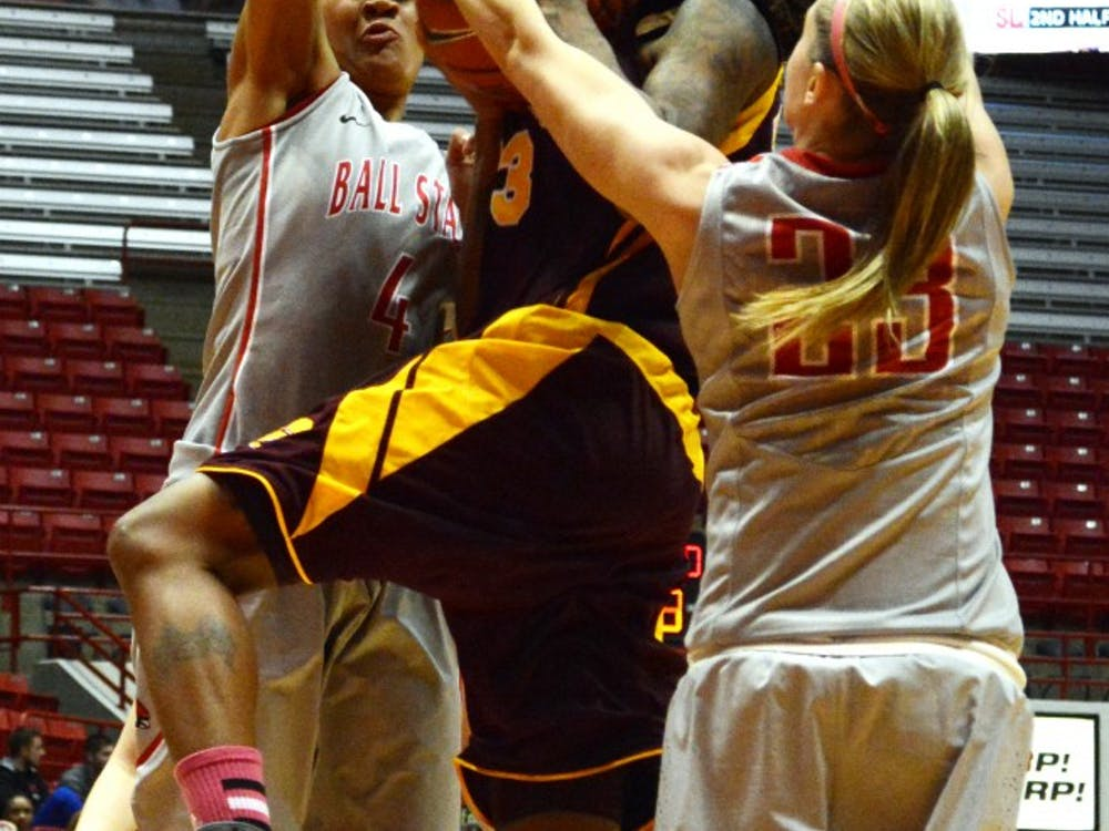 Ball State junior Brittany Carter and sophomore Nathalie Fontaine block a Central Michigan player's shot on Thursday, Feb. 6 at Worthen Arena. DN PHOTO SAMANTHA BLANKENSHIP