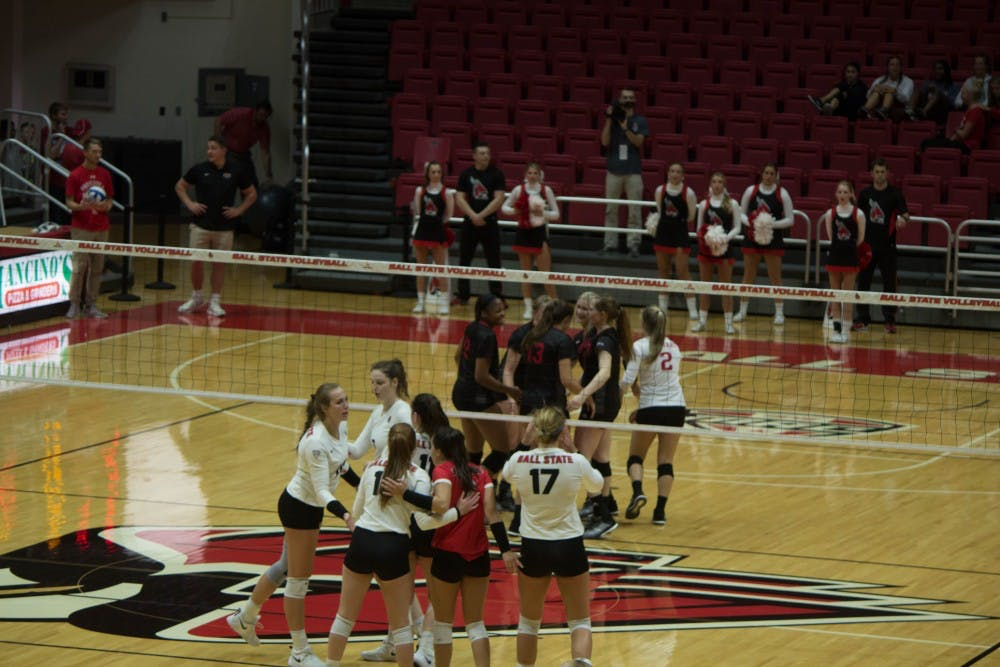 The Ball State Women's Volleyball team regroups between plays Sept.11, 2018, at Worthen Arena. The Cardinals defeated the Jaguars 3-0. Alex Straw,DN