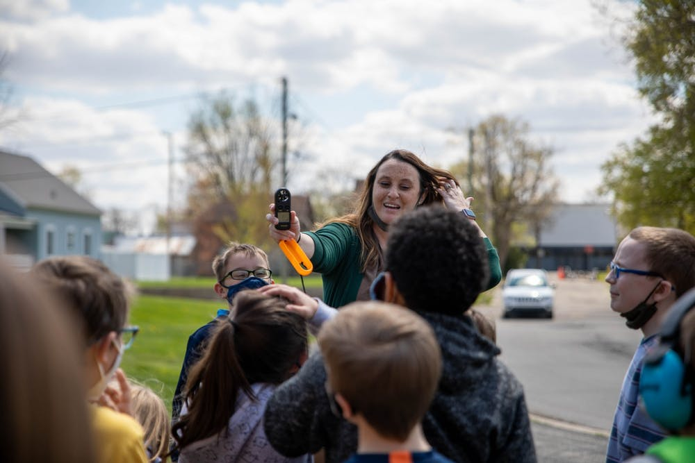 <p>Courtney Williams, third-grade teacher at East Washington Academy, teaches her students how to use an anemometer April 19, 2021. As part of a third-grade project lead the way instruction, students in Muncie Community Schools learn weather patterns and animal life cycles. <strong>Jaden Whiteman, DN</strong></p>