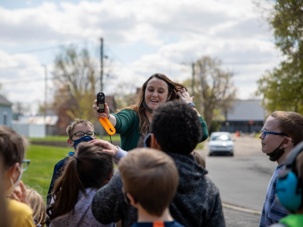 Courtney Williams, third-grade teacher at East Washington Academy, teaches her students how to use an anemometer April 19, 2021. As part of a third-grade project lead the way instruction, students in Muncie Community Schools learn weather patterns and animal life cycles. Jaden Whiteman, DN