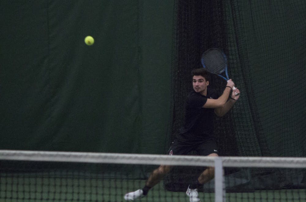 <p>Ball State men's tennis player Marko Guzina goes to return a shot during the doubles set against Eastern Illinois University on Jan. 20 at the Northwest YMCA in Muncie. Guzina and his partner, Conner Andersen, won the set 6-2. <strong>Briana Hale, DN</strong></p>