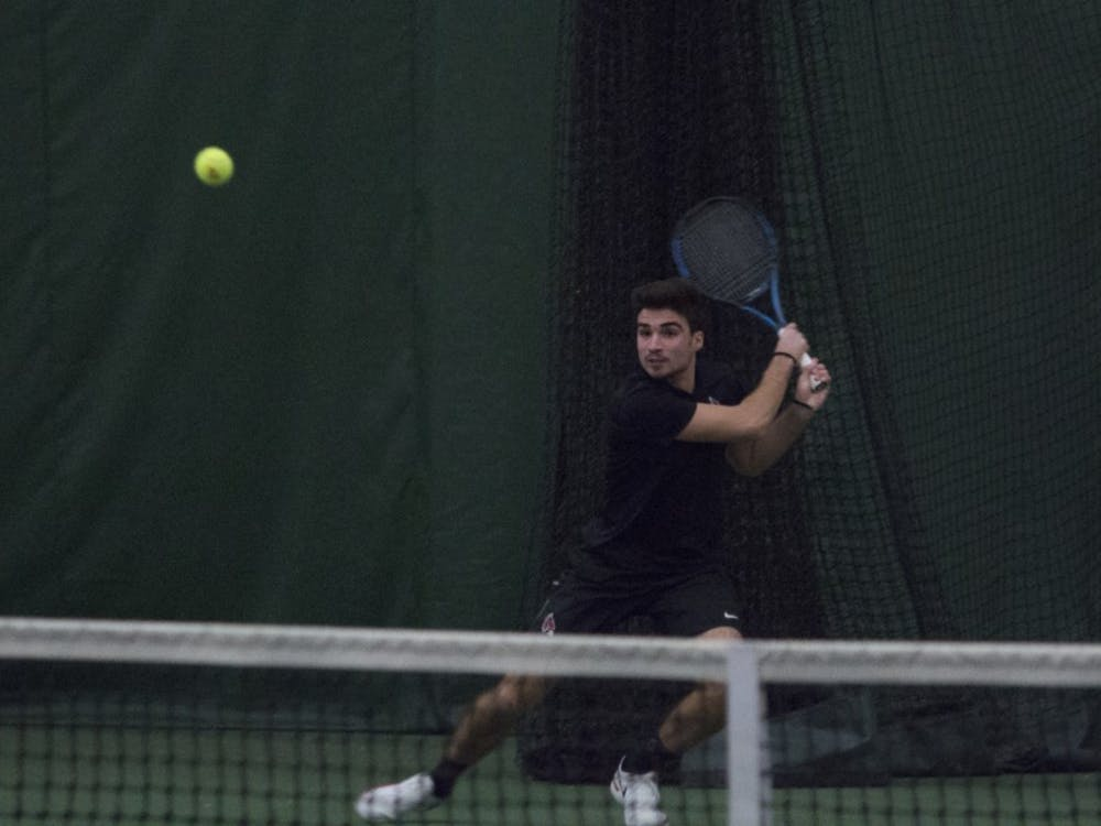 Ball State men's tennis player Marko Guzina goes to return a shot during the doubles set against Eastern Illinois University on Jan. 20 at the Northwest YMCA in Muncie. Guzina and his partner, Conner Andersen, won the set 6-2. Briana Hale, DN