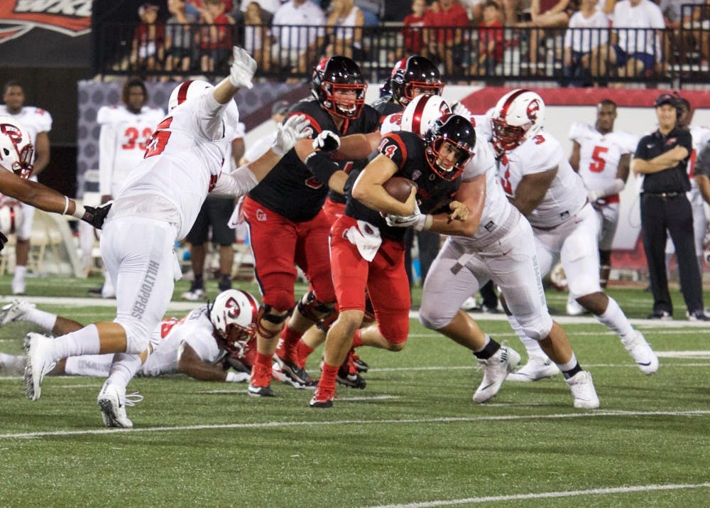 <p>Redshirt sophomore quarter back Jack Milas runs the ball at the game on Sept. 23 against Western Kentucky. The Cardinals lost 21-33. Rebecca Slezak, DN</p>