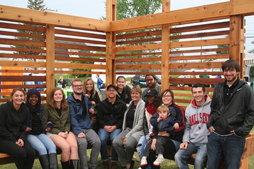 Architecture students sit with professor Pamela Harwood in the Maring-Hunt Community Garden, Spring 2017. Harwood received an award for her leadership of the immersive learning course that designed the garden near Maring-Hunt library. Pamela Harwood, Photo Provided