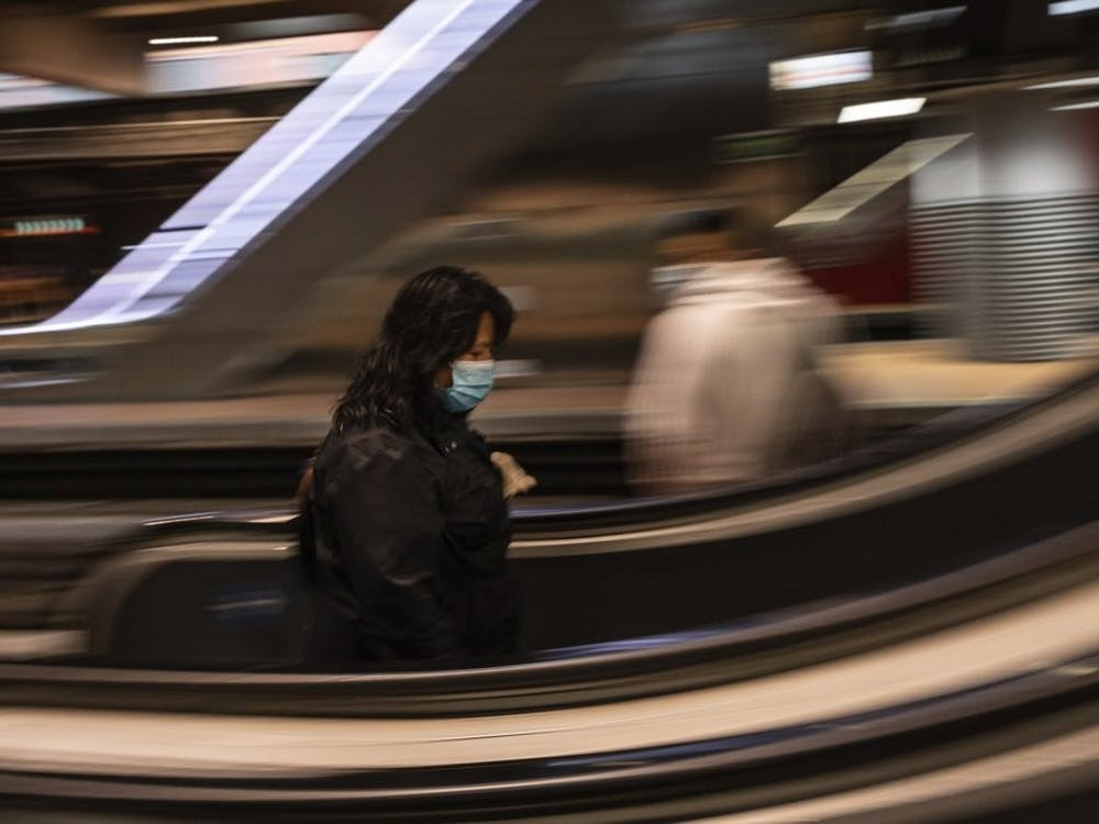 A commuter wears a face mask April 13, 2020, to protect against coronavirus at Atocha train station in Madrid, Spain. Spain is cautiously re-starting some business activity to emerge from the nationwide near-total freeze that helped slow the country's grim coronavirus outbreak. (AP Photo/Bernat Armangue)