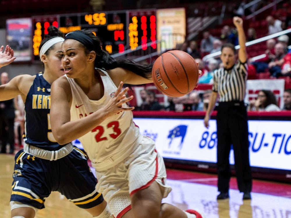 Ball State guard Gabby Smith charges to the basket where she drew a foul from Kent State guard Mariah Modkins in John E. Worthen Arena Jan. 23, 2019. Ball State defeated Kent State to break their losing streak and set their overall record for the season 7-11. Eric Pritchett,DN