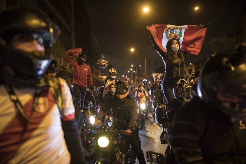 A caravan of demonstrators on motorcycles ride as they wait for news on who will be the country's next president, in Lima, Peru, Sunday, Nov. 15, 2020. Manuel Merino announced his resignation following massive protests, unleashed when lawmakers ousted President Martin Vizcarra. (AP Photo/Rodrigo Abd)
