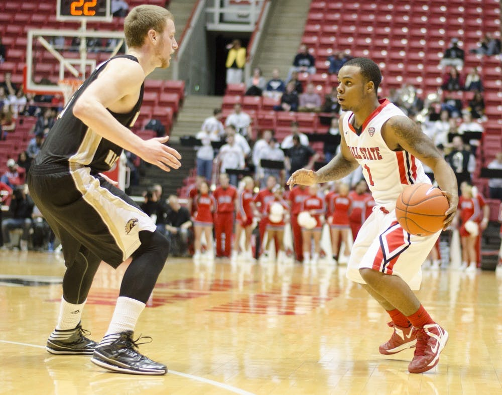 Freshman guard Zavier Turner looks for an open teammate in the second half against Western Michigan on Feb. 26 at Worthen Arena. Turner had a total of 20 points in the game. DN PHOTO BREANNA DAUGHERTY