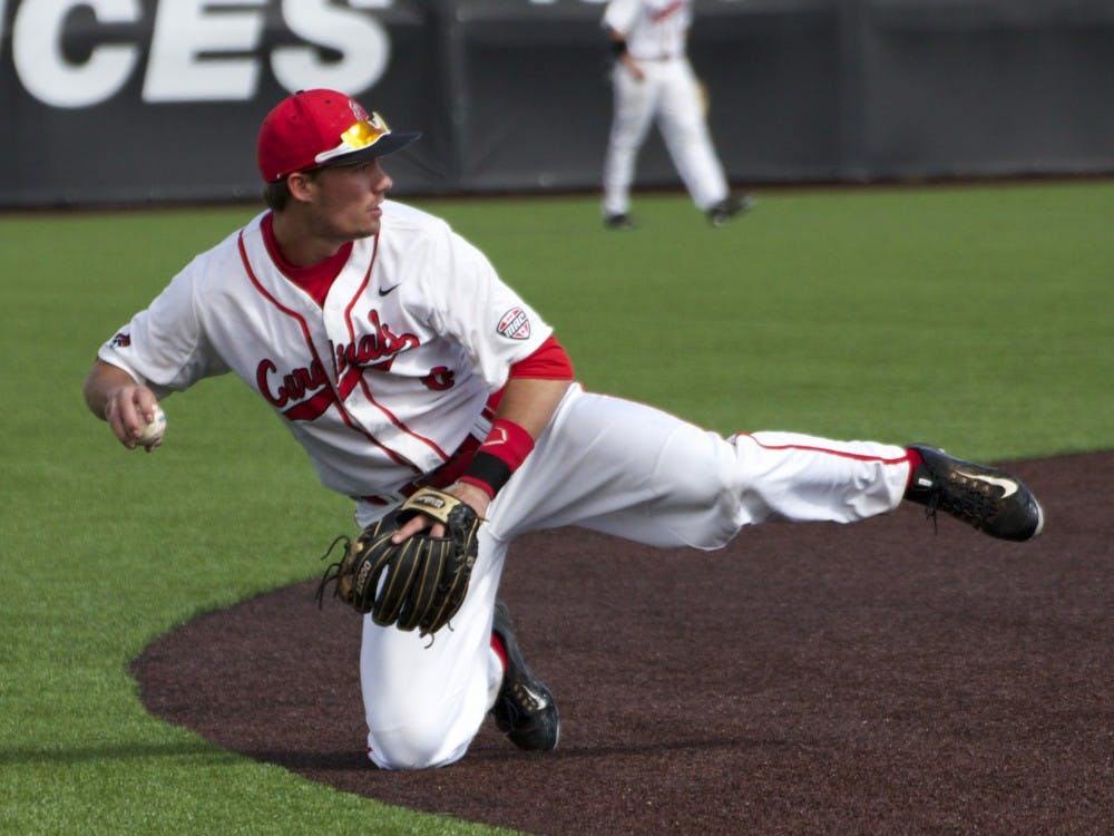 Ball State's junior infielder Alex Maloney turns to throw the ball to the pitcher during the game against Ohio on April 1. DN PHOTO GRACE RAMEY