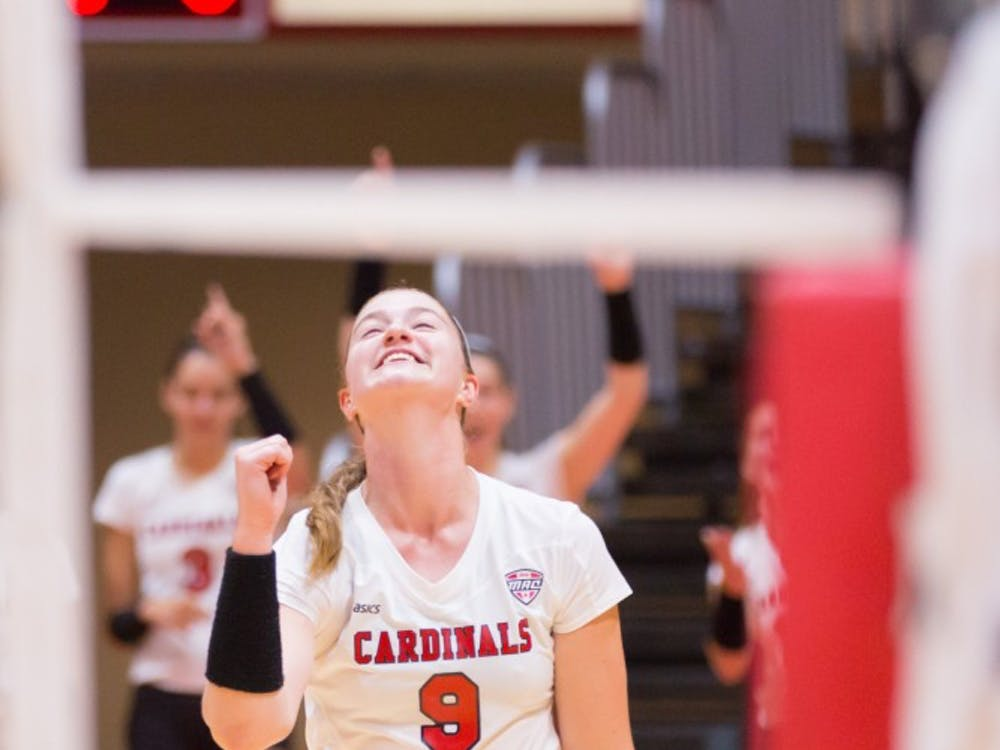 Junior outside hitter Sabrina Mangapora celebrates after a score at the game against IUPUI on Aug. 31 at John E. Worthen Arena. Kyle Crawford // DN