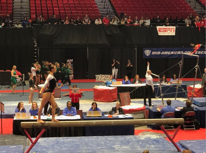 Sophomore Arden Hudson preforms her routine on the beam at the 2019 Gymnastics Mid-American Conference Championship on March 23 at the Convocation Center in DeKalb, Illinois. Ball State took seventh place in the meet. Drew Pierce, DN