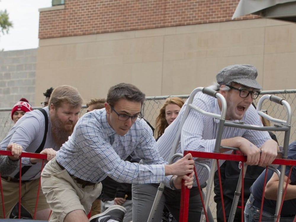 Ball State University students compete in the annual homecoming Bed Race Oct. 19, 2018, on Riverside Ave. The Bed Race is held as a part of Ball States homecoming festivities. Jacob Haberstroh,DN.