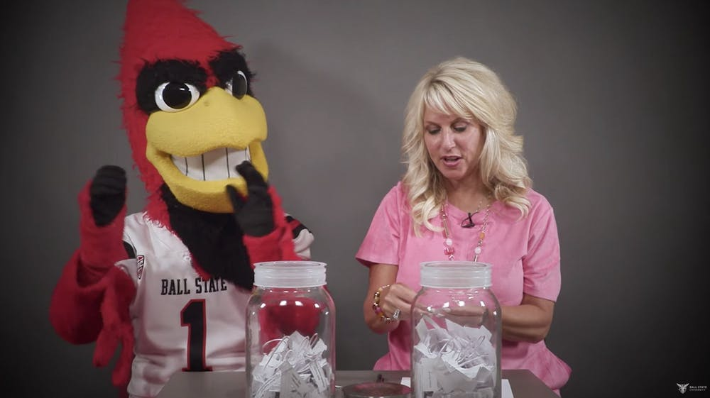<p>Charlie Cardinal claps for student winners of vaccine incentive prizes announced by Kathy Wolf, vice president for marketing and communications, July 14, 2021. Each Wednesday at noon, through Sept. 8, university staff will announce new winners of incentive prizes. <strong>Ball State University YouTube page, Screenshot Capture</strong></p>