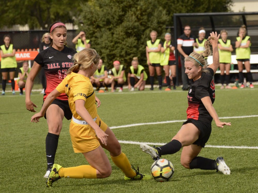 Kent State sophomore and defensive player Amanda Reed, faces off against Ball State University senior, foward/midfielder Allison Abbe Oct. 1, 2017 at Briner Sports Complex. Harrison Raft, DN