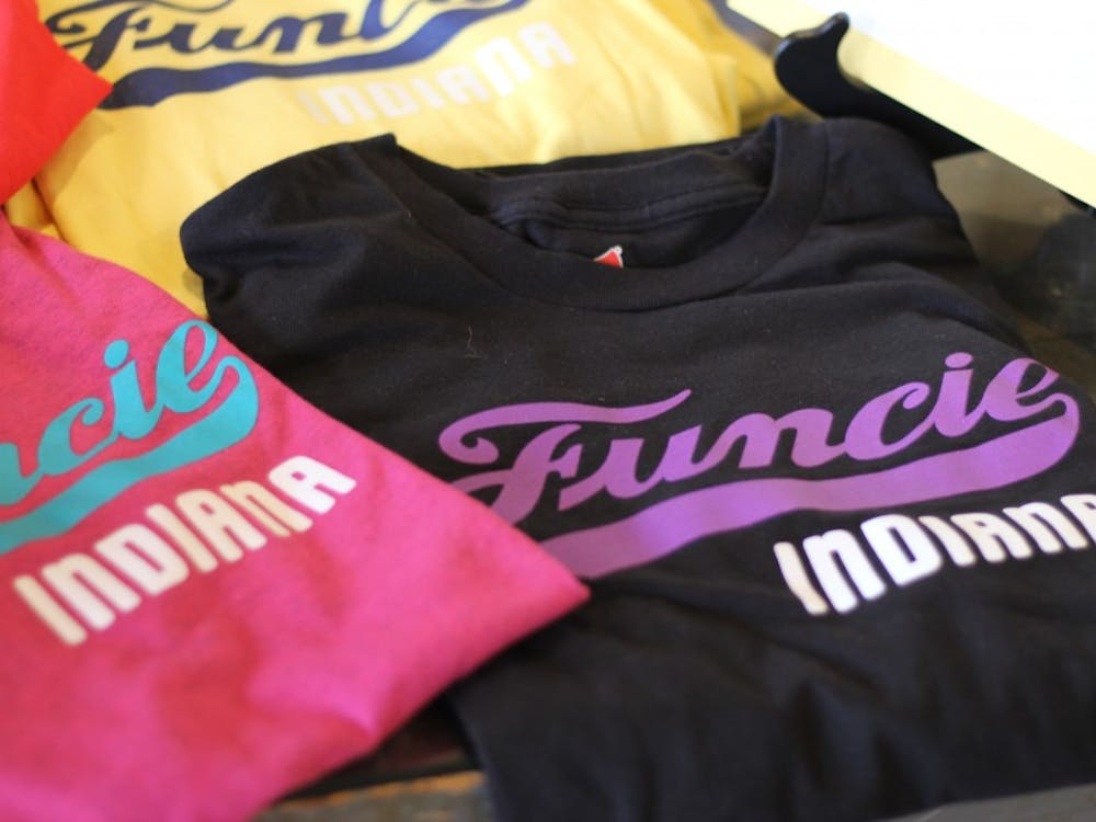 "Shirts reading ""Funcie Indiana"" are on display June 6, 2019, at the First Thursdays event in downtown Muncie. These shirts were developed by John Morris, a graphic design professor. Britney Kendrick, DN"