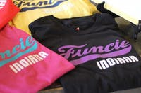 """Shirts reading """"Funcie Indiana"""" are on display June 6, 2019, at the First Thursdays event in downtown Muncie. These shirts were developed by John Morris, a graphic design professor. Britney Kendrick, DN"""