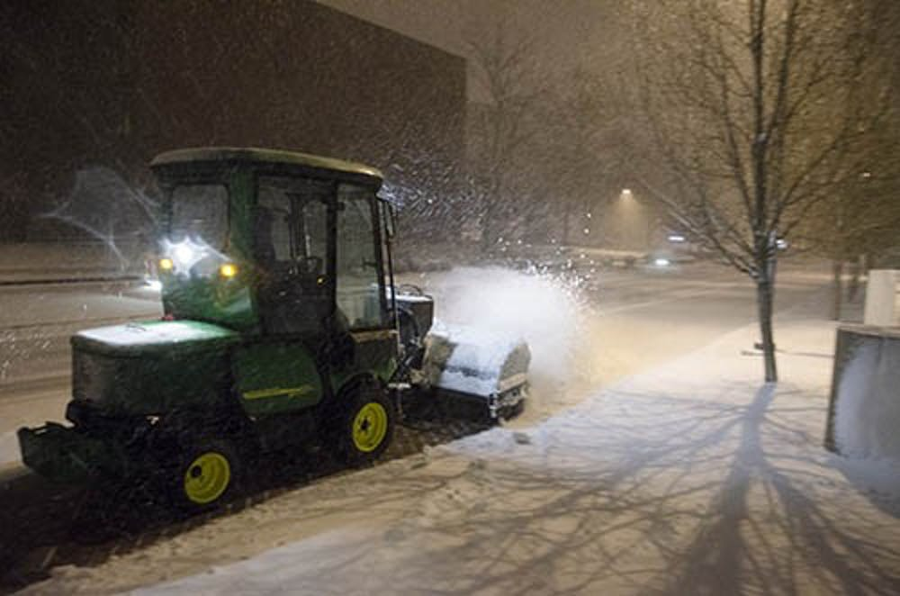Snow removers try to keep up with falling snow Sunday evening as a winter storm advisory is placed on central Indiana. DN PHOTO COREY OHLENKAMP