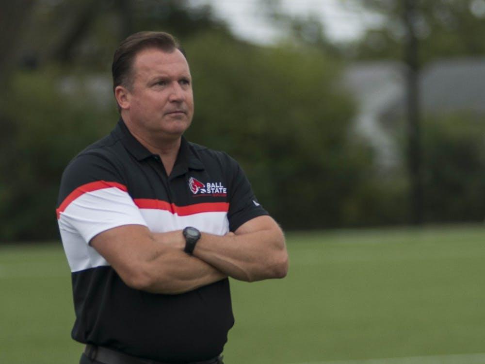 Head Coach Craig Roberts looks onward as the women's soccer team plays Northern Illinois during their 2017 season at the Briner Sports Complex. Roberts was on his eighth season as head coach. Breanna Daugherty, DN File
