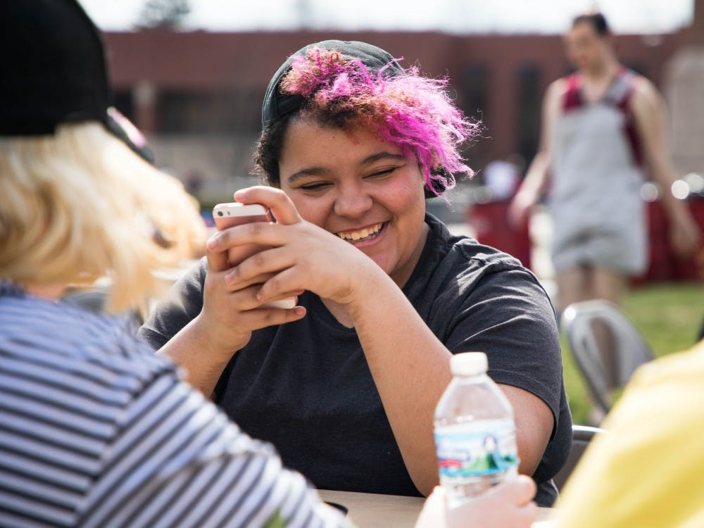During BBQueer on University Green April 13, people gathered to eat pizza. Spectrum, the organization in charge of the event, wanted to share more about who they are and get to know people on campus.