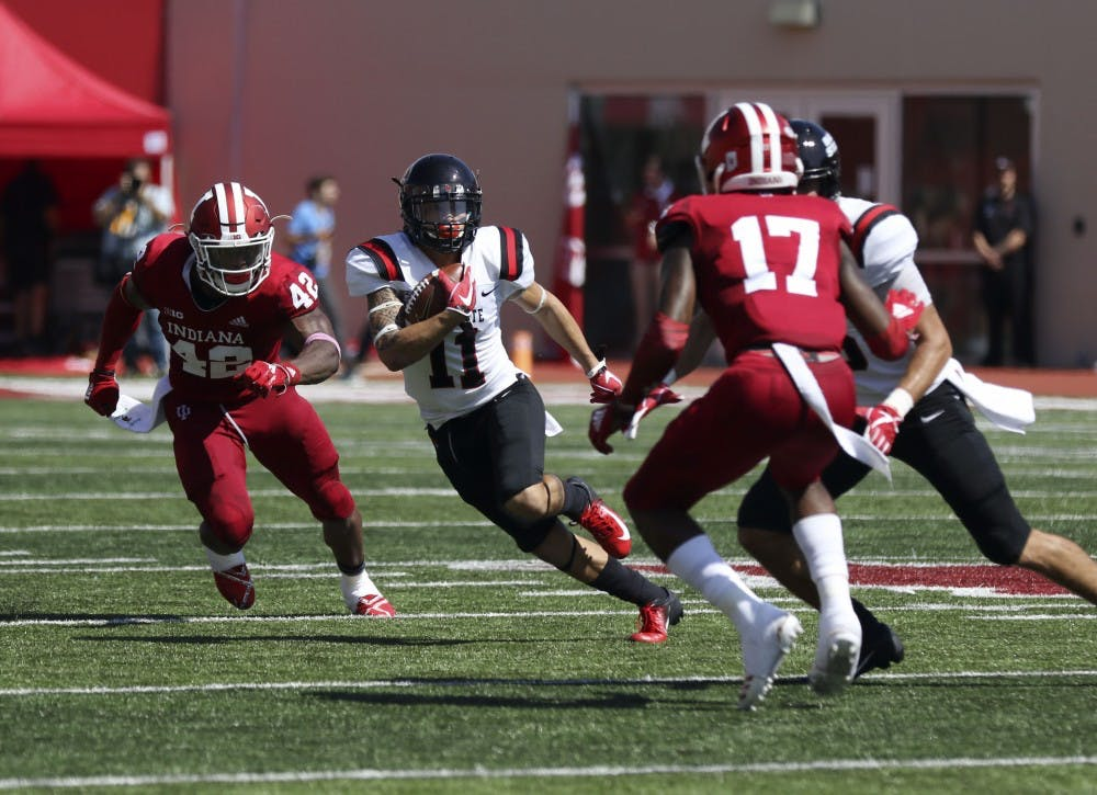 <p>Ball State redshirt senior wide receiver Corey Lacanaria dodges Indiana defenders Marcelino Ball, 42, and Raheem Layne, 17, during the Cardinals' game against the Hoosiers Saturday, Sept. 15, 2018 at Memorial Stadium in Bloomington,IN. Lacanaria had 40 receiving yards. <strong>Paige Grider, DN</strong></p>