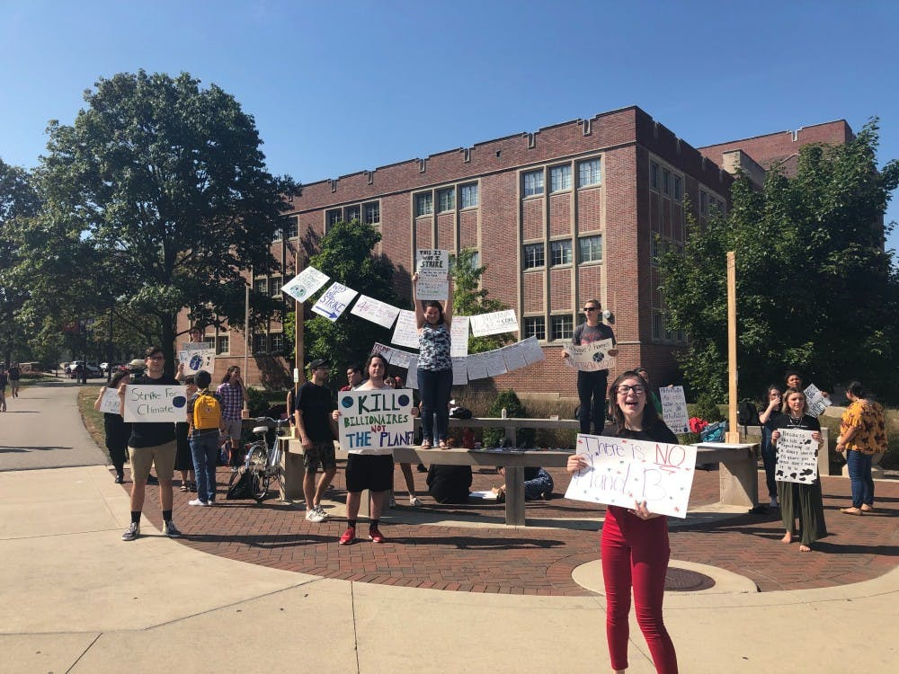 Students took turns throughout the eight hour demonstration to show their support for the climate. On Friday Sept. 21, Ball State students hosted a climate rally at the scramble, as part of a world wide protest. Chase Martin, DN.