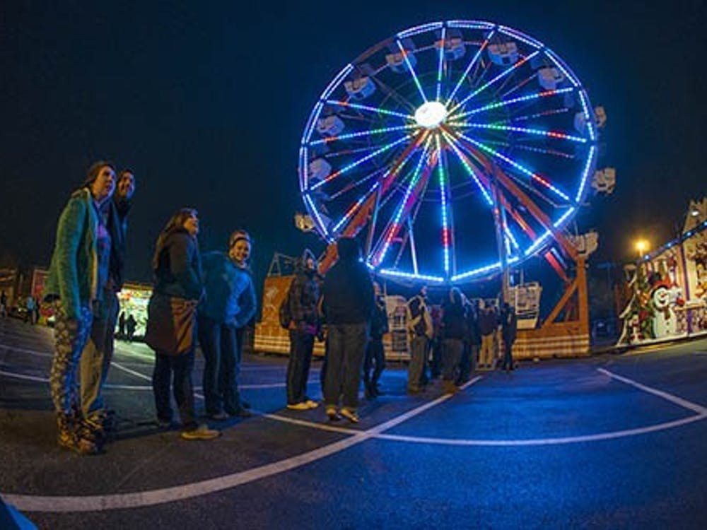 Students wait in line for the ferris wheel during the Late Nite Carnival. The ferris wheel closed down for a stretch of time due to the whether. DN PHOTO JONATHAN MIKSANEK