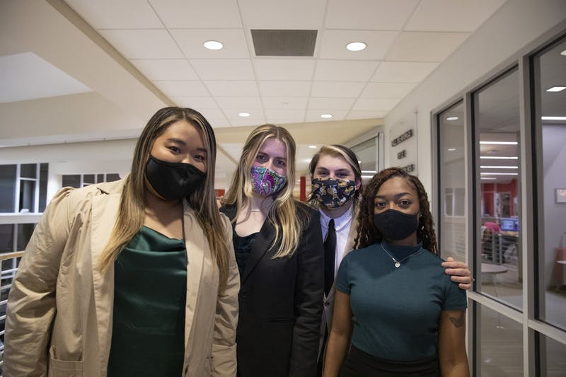 """(From left to right) Tina Nguyen, Chiara Biddle, Jacob Bartolotta and Nita Burton of the Student Government Association (SGA) Strive slate stand together Feb. 10, 2021. SGA held its first """"blitz"""" to get student perspectives on campus issues Sept. 15. Jacob Musselman, DN File"""